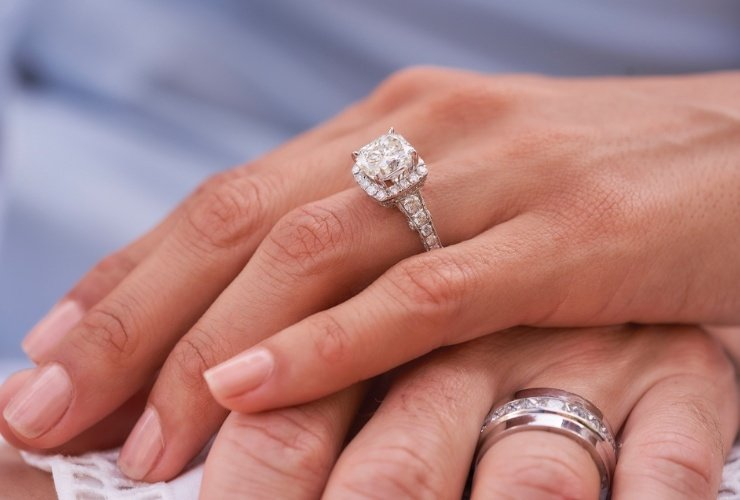 Woman's hand with a diamond ring