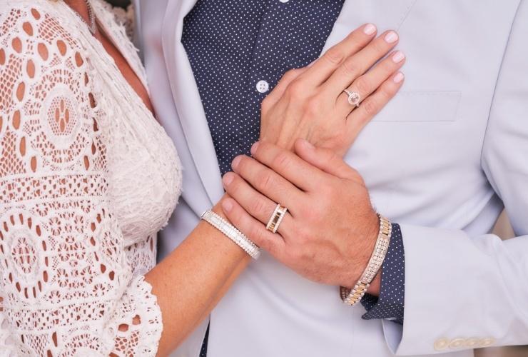 Woman and man wearing anniversary wedding rings