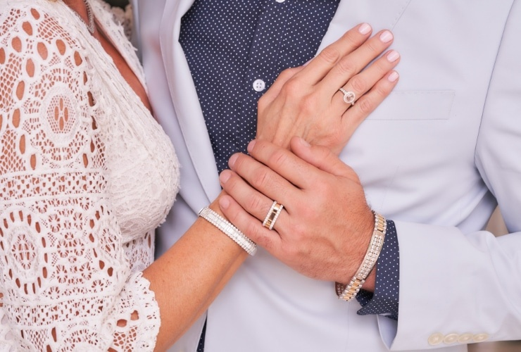Woman and man wearing anniversary wedding rings